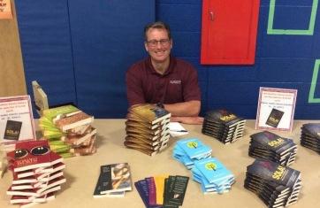 Pastor Jeff Dorth mans the HCD booktable at St. John's West Bend!