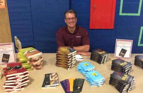 Pastor Jeff Dorth mans the HCD booktable at St. John's West Bend!